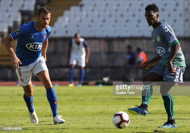 Mano of Vitoria FC with Jonatan Lucca of Belenenses SAD in action during the Liga NOS match between Belenenses SAD and Vitoria FC at Estadio Nacional...