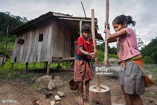 Manobo women pounding rice to remove the outter shell