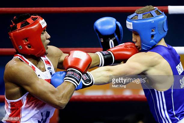 Manoj Kumar of India competes against Bradley Saunders of England in the Light Welter Weight Men Finals Gold Medal Bout at Talkatora Indoor Stadium...