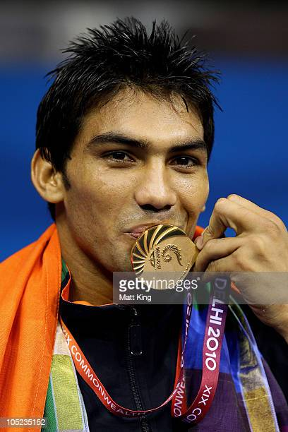 Manoj Kumar of India poses with the gold medal during the medal ceremony for the Light Welter Weight Men Finals Gold Medal Bout atTalkatora Indoor...