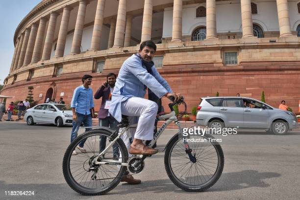 Manoj Tiwari rides a bicycle during the first day of the winter session of Parliament on November 18 2019 in New Delhi India The 250th Rajya Sabha...