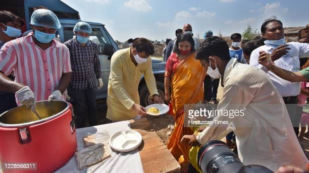 Manoj Tiwari seen serving food to Hindu refugees from Pakistan on the occasion of Prime Minister Narendra Modis 70th birth anniversary Majlis Park...