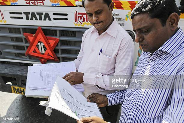 Manoj Zhope antiencroachment officer for a Flying Debris Squad at the Navi Mumbai Municipal Corporation right and Ajit Tandel sanitary officer check...