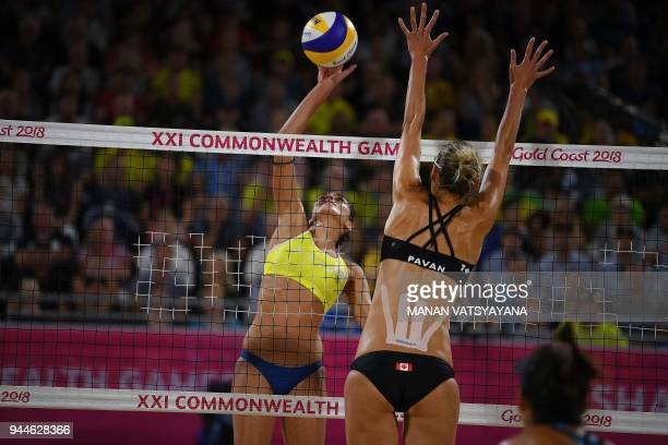 Manolina Konstantinou of Cyprus hits a shot past Sarah Pavan of Canada during their women's beach volleyball semifinal match of the 2018 Gold Coast...