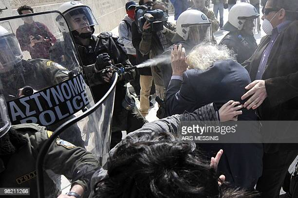 Manolis Glezos Greek left wing politician and writer known especially for his participation in the World War II resistance is attacked by riot police...