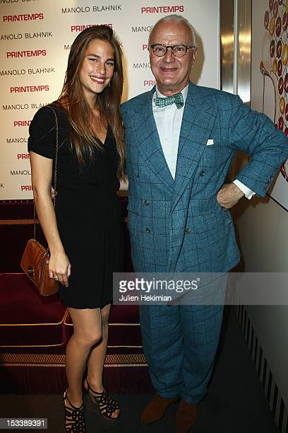Manolo Blahnik and Solene Hebert attend the 'Manolo Blahnik' opening exhibition cocktail at Printemps Haussmann on October 4 2012 in Paris France