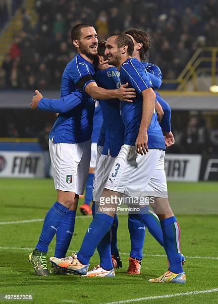 Manolo Gabbiadini celebrate with teammate Leonardo Bonucci and Giorgio Chiellini after scoring a goal during the international friendly match between...