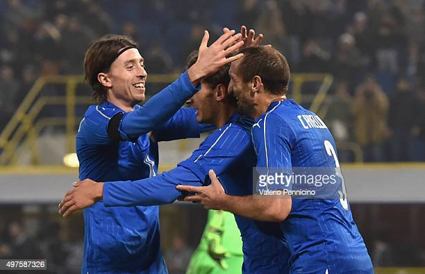 Manolo Gabbiadini celebrate with teammate Riccardo Montolivo and Giorgio Chiellini after scoring a goal during the international friendly match...