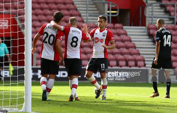 Manolo Gabbiadini celebrates with Steven Davis and Dusan Tadic after scoring Southampton's second during the preseason friendly between Southampton...
