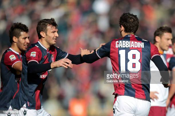 Manolo Gabbiadini of Bologna FC celebrates with teammates after scoring his team's first goal to equalise during the Serie A match between Bologna FC...
