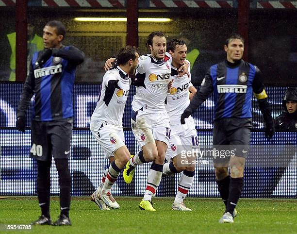 Manolo Gabbiadini of Bologna FC celebrates with teammates scoring the second goal during the TIM cup match between FC Internazionale Milano and...