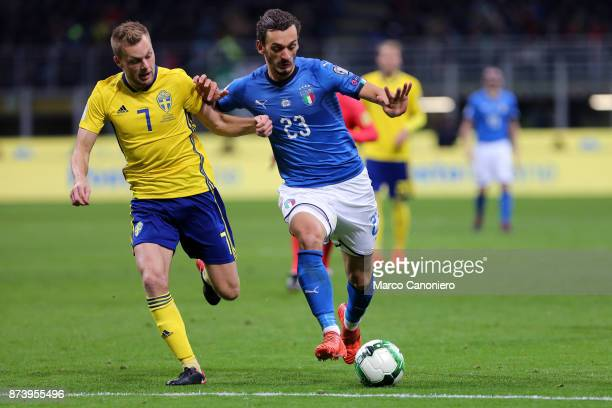 Manolo Gabbiadini of Italy and Sebastian Larsson of Sweden in action during the FIFA 2018 World Cup playoff Qualifier match between Italy and Sweden...