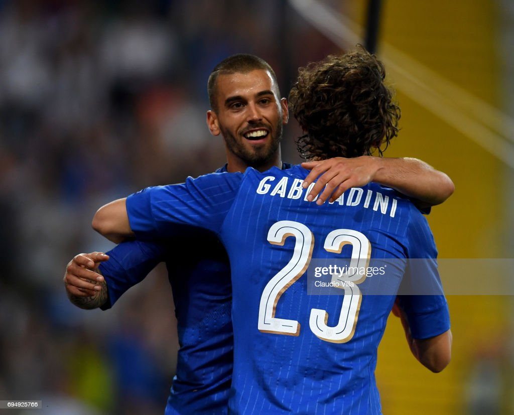 Manolo Gabbiadini of Italy celebrates after scoring with Leonardo Spinazzola the fifth goal during the FIFA 2018 World Cup Qualifier between Italy and Liechtenstein at Stadio Friuli on June 11, 2017 in Udine, Italy.