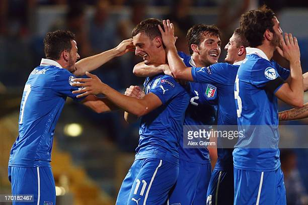 Manolo Gabbiadini of Italy celebrates his team's third goal with team mate Alessandro Florenzi during the UEFA European U21 Championship Group A...