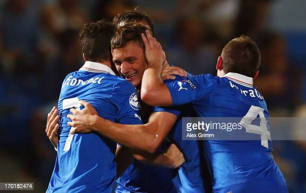 Manolo Gabbiadini of Italy celebrates his team's third goal with team mates Alessandro Florenzi and Marco Verratti during the UEFA European U21...