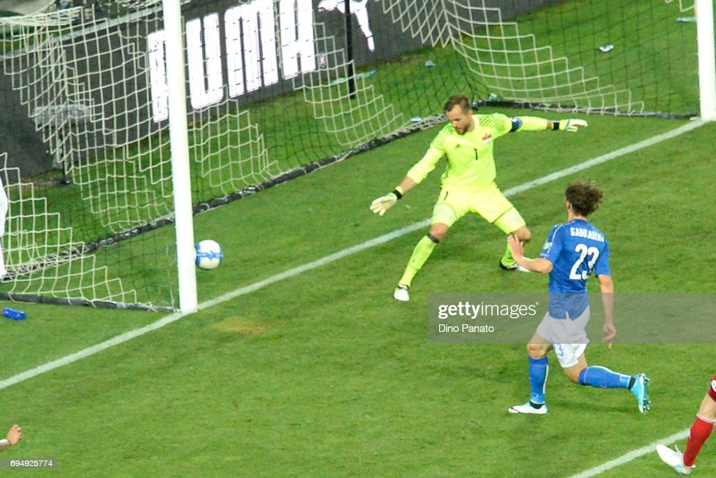 Manolo Gabbiadini (R) of Italy scores his team's fivteth goal during the FIFA 2018 World Cup Qualifier between Italy and Liechtenstein at Stadio Friuli on June 11, 2017 in Udine, Italy.