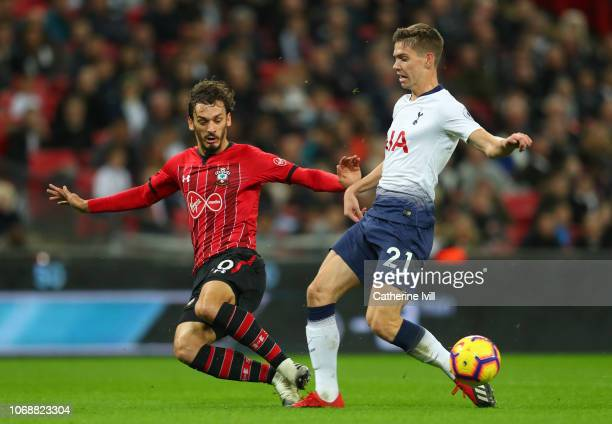 Manolo Gabbiadini of Southampton battles for possession with Juan Foyth of Tottenham Hotspur during the Premier League match between Tottenham...