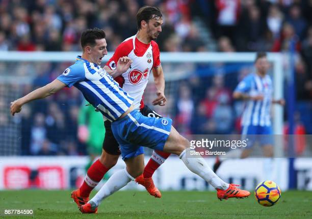Manolo Gabbiadini of Southampton battles with Lewis Dunk of Brighton and Hove Albion during the Premier League match between Brighton and Hove Albion...
