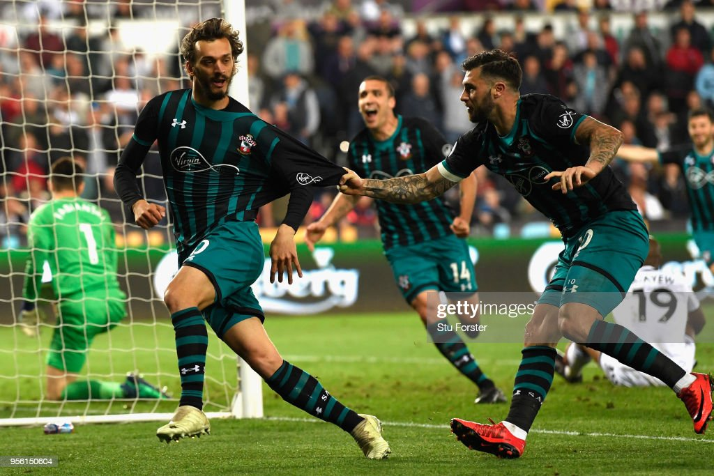 Manolo Gabbiadini of Southampton celebrates with Charlie Austin after he scores his sides first goal during the Premier League match between Swansea City and Southampton at Liberty Stadium on May 8, 2018 in Swansea, Wales.