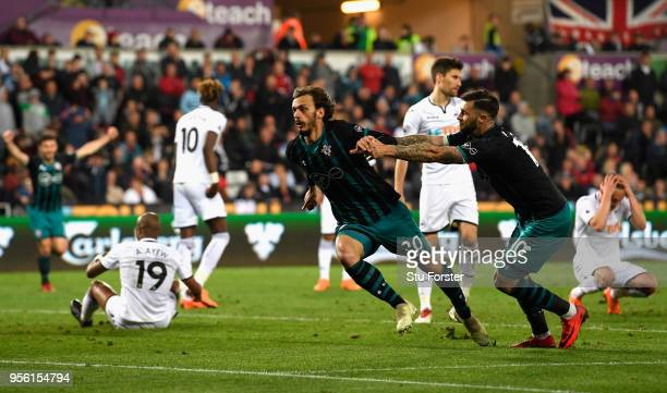 Manolo Gabbiadini of Southampton celebrates with Charlie Austin after he scores his sides first goal during the Premier League match between Swansea...