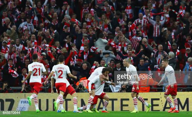 Manolo Gabbiadini of Southampton celebrates with team mates and fans as he scores their second goal during the EFL Cup Final match between Manchester...