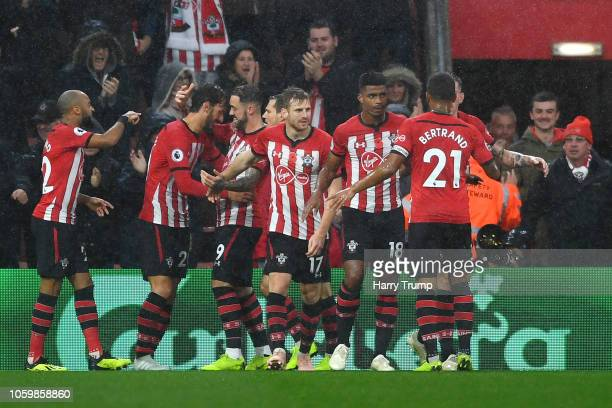 Manolo Gabbiadini of Southampton celebrates with teammates after scoring his team's first goal during the Premier League match between Southampton FC...