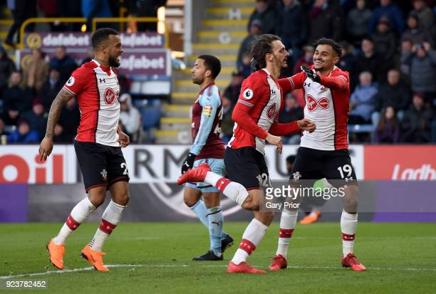 Manolo Gabbiadini of Southampton celebrates with teammates after scoring his sides first goal during the Premier League match between Burnley and...