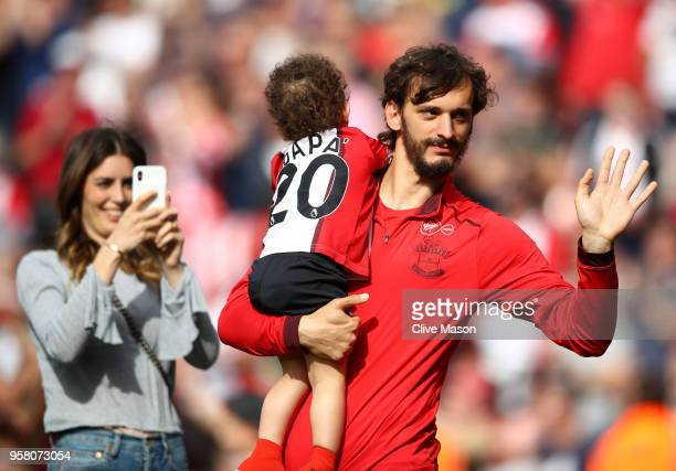 Manolo Gabbiadini of Southampton enjoys the lap of honour with his child after the the Premier League match between Southampton and Manchester City...