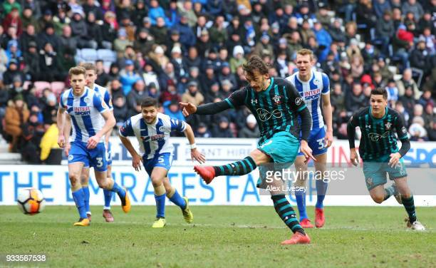 Manolo Gabbiadini of Southampton misses a penalty as it is saved by Christian Walton of Wigan Athletic during The Emirates FA Cup Quarter Final match...