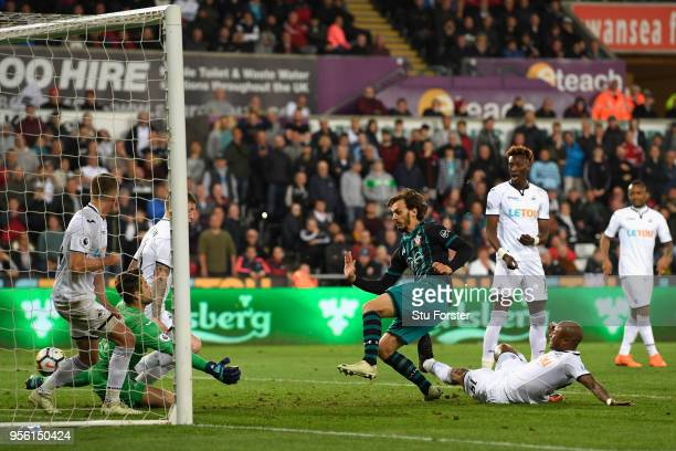 Manolo Gabbiadini of Southampton scores his sides first goal during the Premier League match between Swansea City and Southampton at Liberty Stadium...
