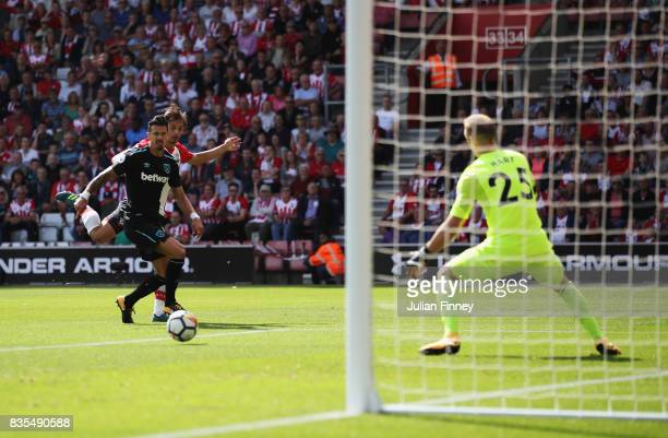 Manolo Gabbiadini of Southampton scores his sides first goal past Joe Hart of West Ham United during the Premier League match between Southampton and...