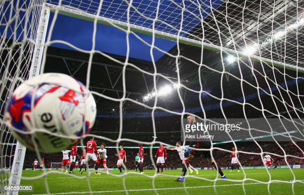 Manolo Gabbiadini of Southampton scores their second goal past goalkeeper David De Gea of Manchester United during the EFL Cup Final match between...