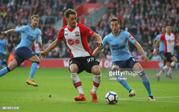 Manolo Gabbiadini of Southampton shields the ball from Javi Manquillo of Newcastle United before he scores their first and equalising goal during the...