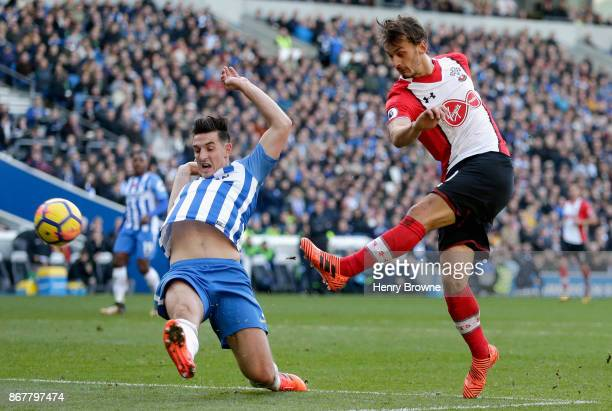 Manolo Gabbiadini of Southampton shoots past Lewis Dunk of Brighton and Hove Albion during the Premier League match between Brighton and Hove Albion...