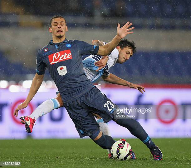 Manolo Gabbiadini of SSC Napoli competes for the ball with Danilo Cataldi SS Lazio during the TIM Cup match between SS Lazio and SSC Napoli at Stadio...
