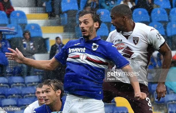 Manolo Gabbiadini of UC Sampdoria and Gleison Bremer of Torino FC during the Serie A match between UC Sampdoria and Torino FC at Stadio Luigi...