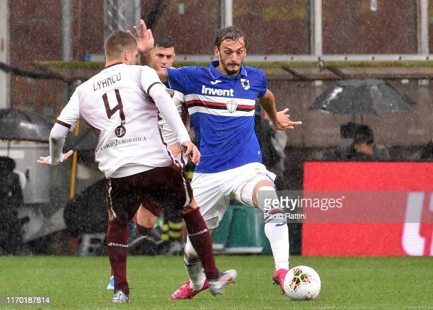 Manolo Gabbiadini of UC Sampdoria and Lyanko of Torino FC during the Serie A match between UC Sampdoria and Torino FC at Stadio Luigi Ferraris on...