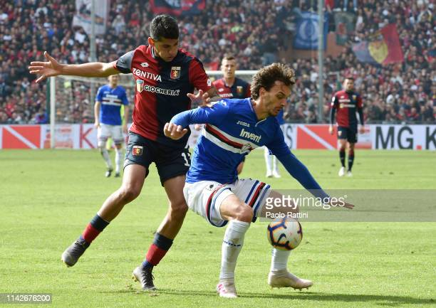 Manolo Gabbiadini of UC Sampdoria defend the ball from Cristian Romero of Genoa CFC attack during the Serie A match between UC Sampdoria and Genoa...