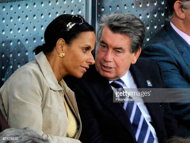Manolo Santana and girlfriend Claudia attend Madrid Open tennis tournament at La Caja Magica on May 15 2009 in Madrid Spain