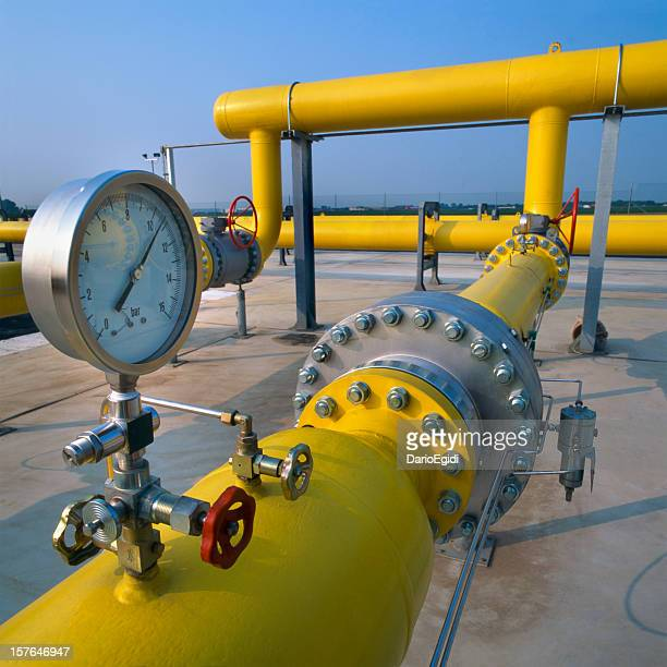 Manometer on yellow pipes in a gas distribution station
