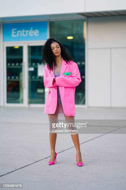 Manon Bresch wears a seethrough dress over a mauve top a white Jacquemus crossbody small cylindric bag a pink tweed Jacquemus oversized jacket...
