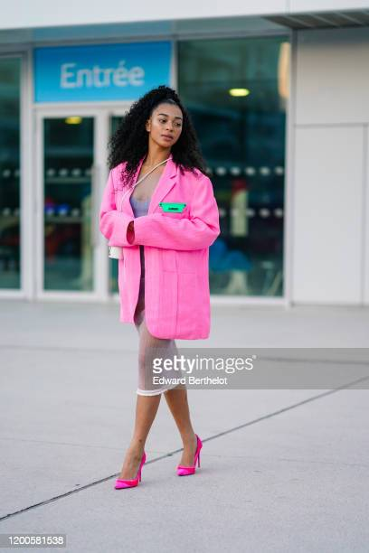 Manon Bresch wears a seethrough dress over a mauve top a white Jacquemus crossbody small bag a pink tweed Jacquemus oversized jacket neonpink and red...