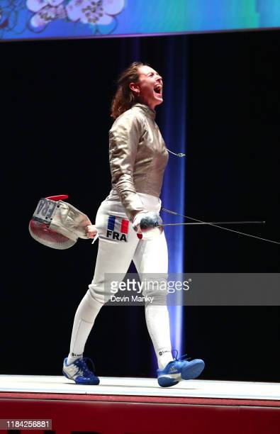 Manon Brunet of France celebrates a win against Olga Nikitina of Russia during the gold medal round of competition at the Women's Sabre World Cup on...
