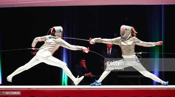 Manon Brunet of France fences against Olga Nikitina of Russia during the gold medal round of competition at the Women's Sabre World Cup on November...