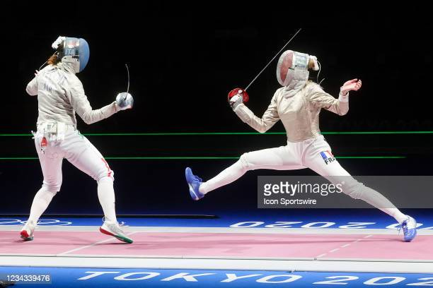 Manon Brunet of Team France attacks Irene Vecchi of Team Italy during the Women's Sabre Fencing Team Semifinal between Team France and Team Italy on...