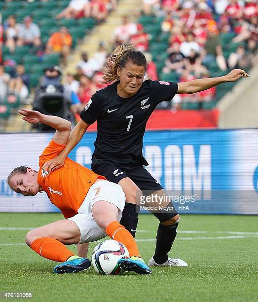 Manon Melis of Netherlands and Ali Riley of New Zealand battle for control of the ball during the FIFA Women's World Cup Canada 2015 Group A match...