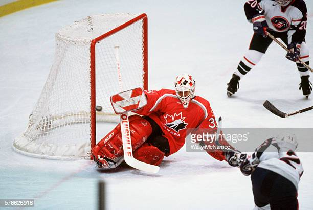 Manon Rheaume goalie for the Canadian ice hockey team defends the goal during the final game at the 1998 Winter Olympics The Americans win the gold...