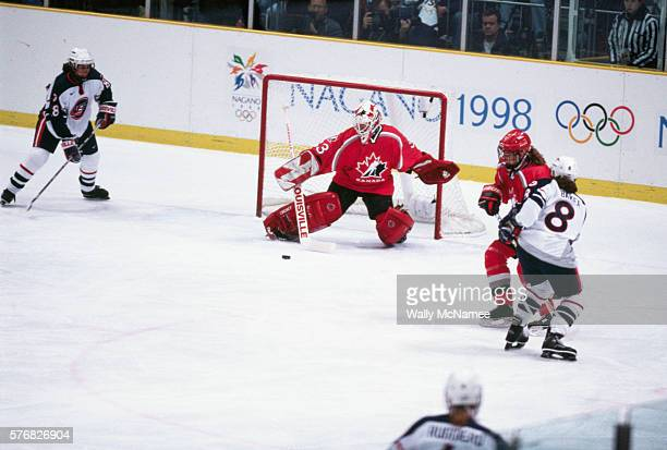 Manon Rheaume goalie for the Canadian women's ice hockey team blocks a shot during the final game at the 1998 Winter Olympics The American win the...