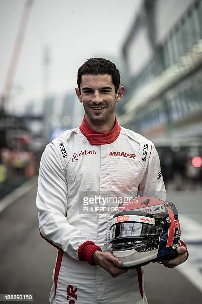 Manor Marussia F1 Team's US driver Alexander Rossi poses for a photo before the practice session of the Formula One Singapore Grand Prix in Singapore...