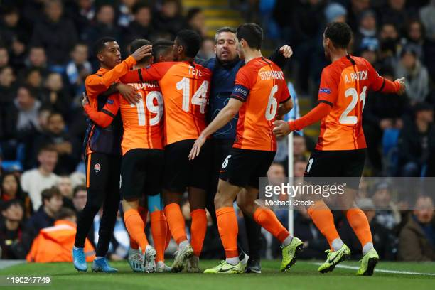 Manor Solomon of Shakhtar Donetsk celebrates with teammates after scoring his team's first goal during the UEFA Champions League group C match...